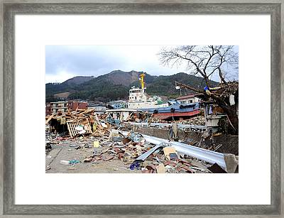 A Tug Boat Rests Upright Among Framed Print by Everett