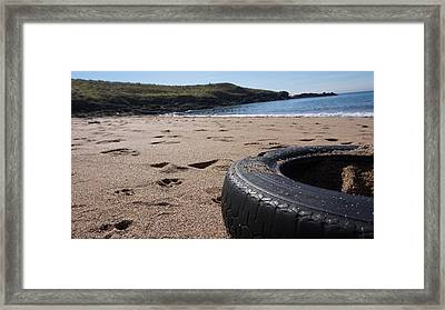 A Tyre By The Sea Framed Print