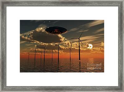 A Ufo Flying Above An Ocean Wind Farm Framed Print by Mark Stevenson
