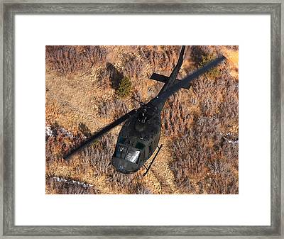 A Uh-1 Huey In Flight Framed Print by Stocktrek Images