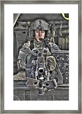A Uh-60 Black Hawk Door Gunner Manning Framed Print by Terry Moore