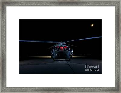 A Uh-60 Black Hawk Helicopter Lit Framed Print