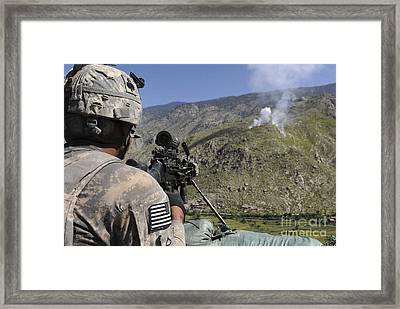 A U.s. Army Grenadier Scans A Nearby Framed Print by Stocktrek Images
