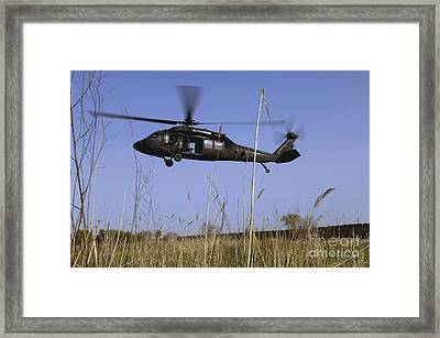 A U.s. Army Uh-60 Black Hawk Helicopter Framed Print by Stocktrek Images
