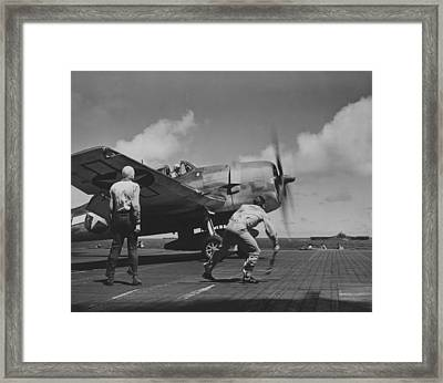A Us Navy Fighter Pilot Gets The Take Off Flag From The Deck Crew Of An Aircraft Carrier Framed Print by American School