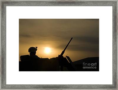 A Us Soldier Mans His .50 Caliber While Framed Print by Terry Moore
