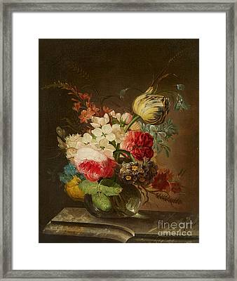 A Vase Of Flowers On A Marble Ledge Framed Print
