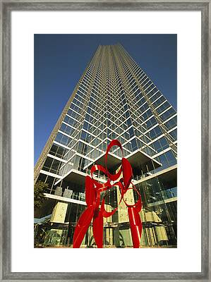 A View Of A Skyscraper With Modern Art Framed Print