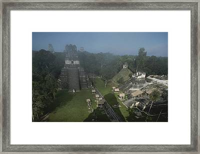 A View Of Mayan Ruins At Tikal Framed Print by Kenneth Garrett