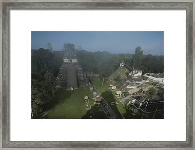 A View Of Mayan Ruins At Tikal Framed Print by Kenneth Garrett