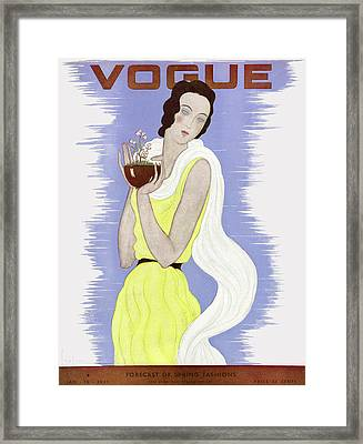 A Vogue Cover Of A Woman Holding A Potted Plant Framed Print