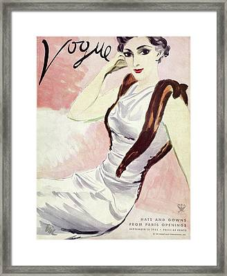 A Vogue Cover Of A Woman Wearing A Fur Stole Framed Print by Carl Oscar August Erickson