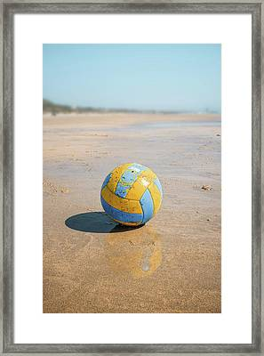 A Volleyball On The Beach Framed Print by Carlos Caetano