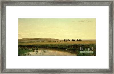 A Wagon Train On The Plains Framed Print