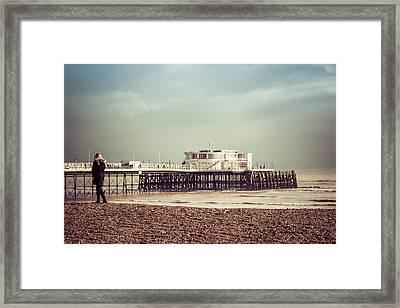 A Walk By The Pier Framed Print by David Warrington