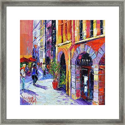 A Walk In The Lyon Old Town Framed Print by Mona Edulesco