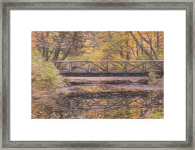 A Walking Bridge Reflection On Peaceful Flowing Water. Framed Print