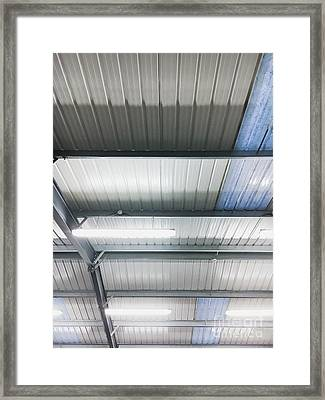 A Warehouse Ceiling Framed Print by Tom Gowanlock
