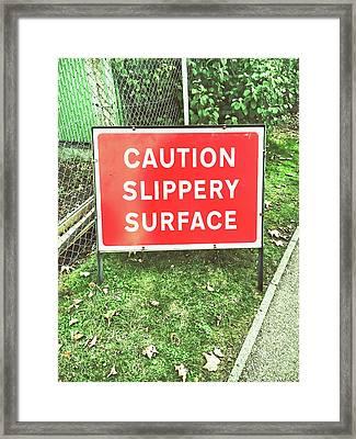 A Warning Sign Framed Print by Tom Gowanlock