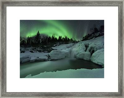 A Wintery Waterfall And Aurora Borealis Framed Print by Arild Heitmann
