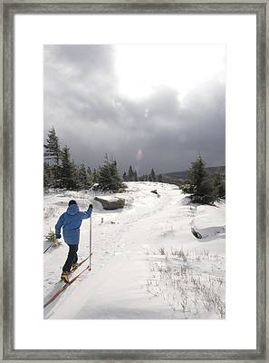 A Woman Cross Country Skiing Framed Print by Skip Brown