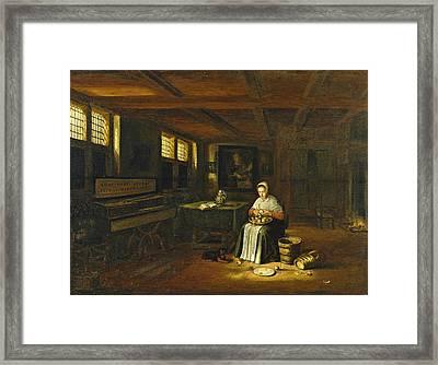 A Woman In An Interior Peeling Vegetables Framed Print by Govert Dircksz Camphuysen