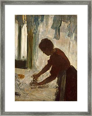 Framed Print featuring the painting A Woman Ironing by Edgar Degas