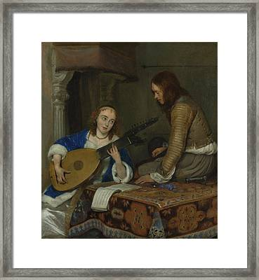 A Woman Playing The Theorbo Framed Print by Gerard ter Borch
