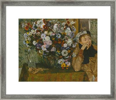 A Woman Seated Beside A Vase Of Flowers Framed Print by Edgar Degas