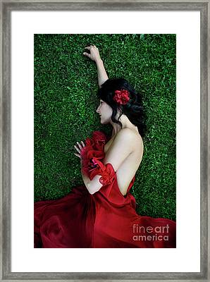 A Woman Sleeping On The Grass In A Red Dress Framed Print by Jelena Jovanovic