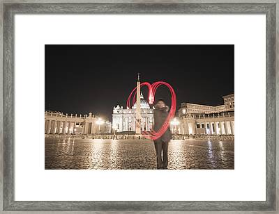 A Woman Stands With A Red Light Trail Framed Print