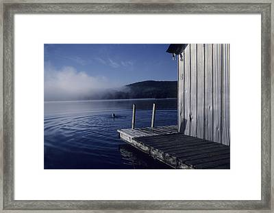 A Woman Swims In A Lake On An Early Framed Print by Taylor S. Kennedy