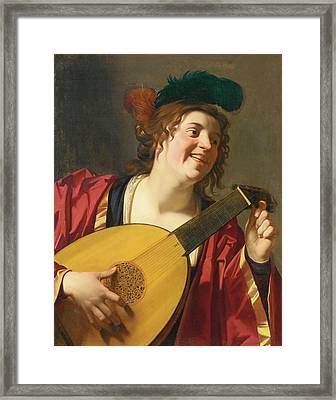 A Woman Tuning A Lute Framed Print