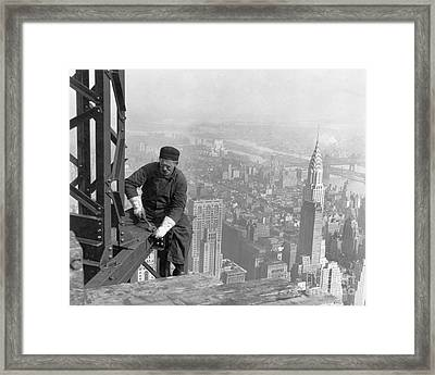 A Worker Bolts Beams During Construction Framed Print