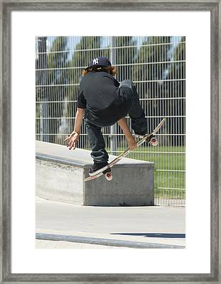 A Young Boy Flying Through The Air Framed Print by Stephen Sharnoff