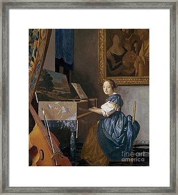 A Young Lady Seated At A Virginal Framed Print by Jan Vermeer
