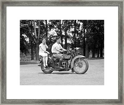 A Young Man Drives A  Motorcycle While Framed Print