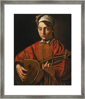 A Young Man Playing A Lute Framed Print by Follower of the Master of the Lute Player