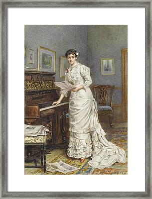 A Young Woman At A Piano Framed Print
