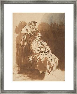 A Young Woman Having Her Hair Braided Framed Print by Rembrandt