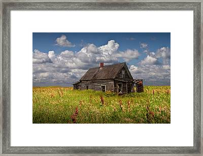 Abandoned Prairie Farm House Under Cloudy Blue Skies Framed Print