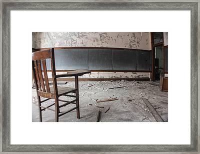 Abandoned School Chair  Framed Print