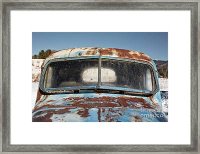Abandoned Truck In Snowy Field Framed Print by Edward Fielding