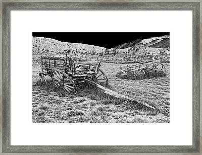Abandoned Wagons Of Bannack Montana Ghost Town Framed Print by Daniel Hagerman