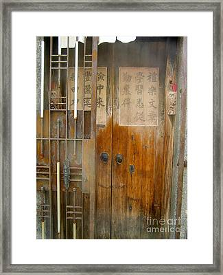 Abandoned Wooden Door With Gate Framed Print by Kathy Daxon