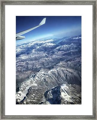 above the Swiss Alps Framed Print by HD Connelly