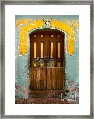 abstract architecture photograph - Door with Yellow Bars Framed Print