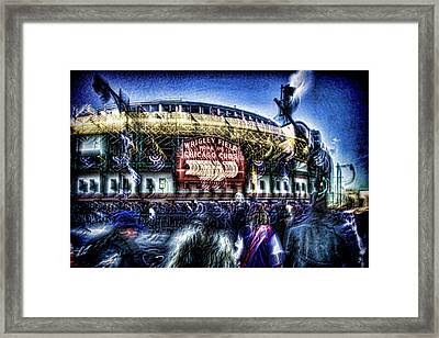 abstract look at the crowd filing in for a Cub's game Framed Print