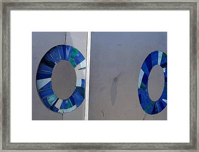 Abstract Of Two Blue Circles On A Wall Framed Print