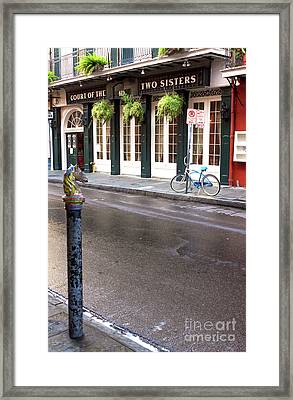 Across The Street In The French Quarter Framed Print by John Rizzuto